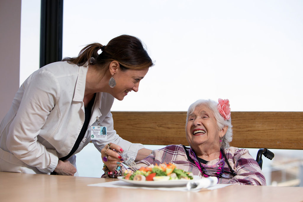 Nurse and patient celebrate her birthday with a cake