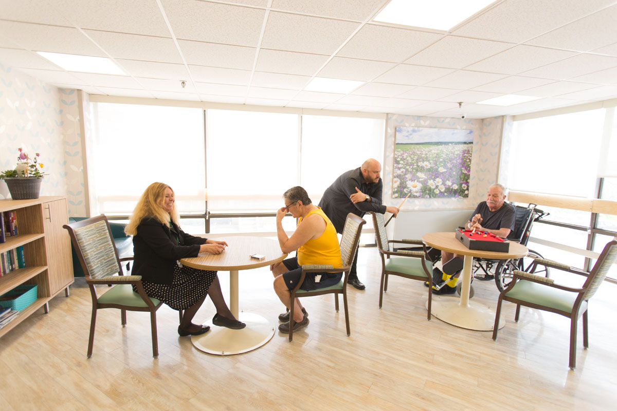 Recreation room with people playing games
