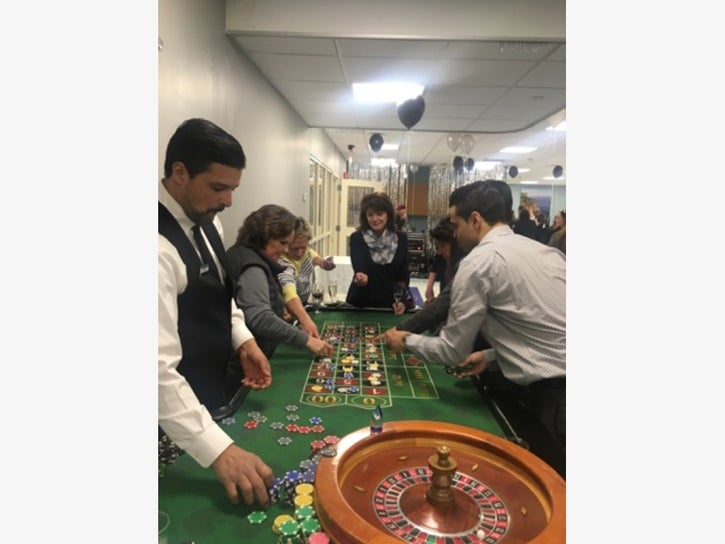 Craps table, dealer, and players